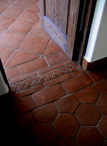 Terra-cotta floor patterns in Santa Barbara style Spanish homes